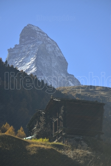 Wooden antique houses from old village from zermatt with matterhorn peak in background