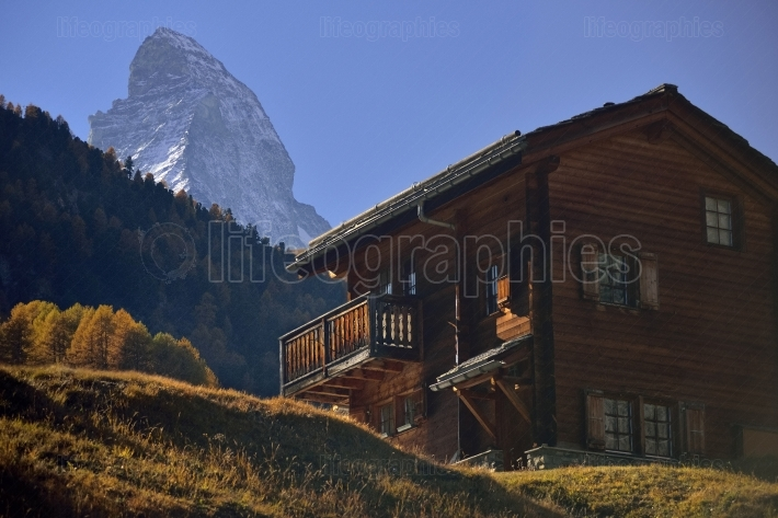 Wooden house from old village from zermatt with matterhorn peak in background