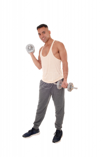 Working out young man standing with two dumbbells