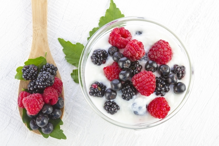 Yogurt with forest berries in a bowl