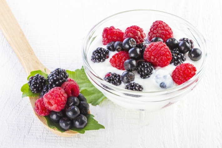 Yogurt with forest berries in bowl