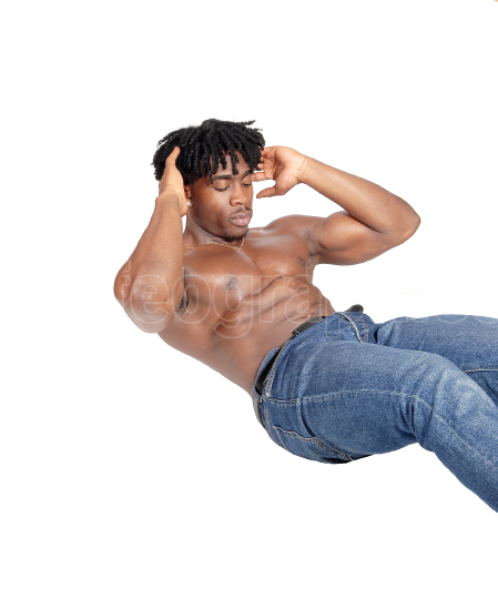 Young African man sitting on floor doing push ups