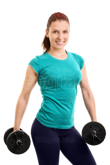 Young athlete holding dumbbells