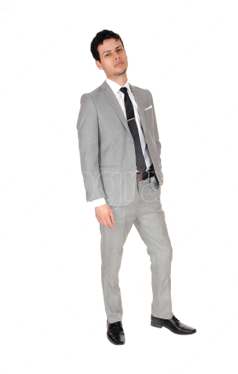 Young business man standing relaxed in a gray suit
