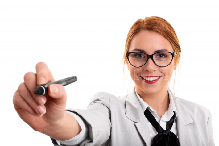 Young business woman pointing at a virtual point with a pen