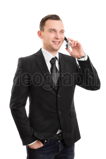 Young businessman talking on a phone