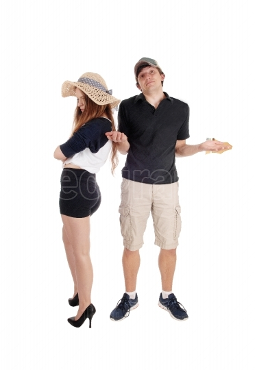 Young couple arguing, standing helpless