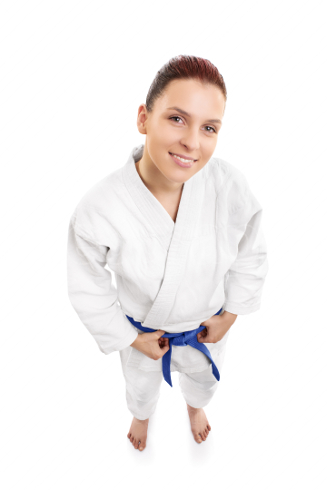 Young female aikido fighter smiling
