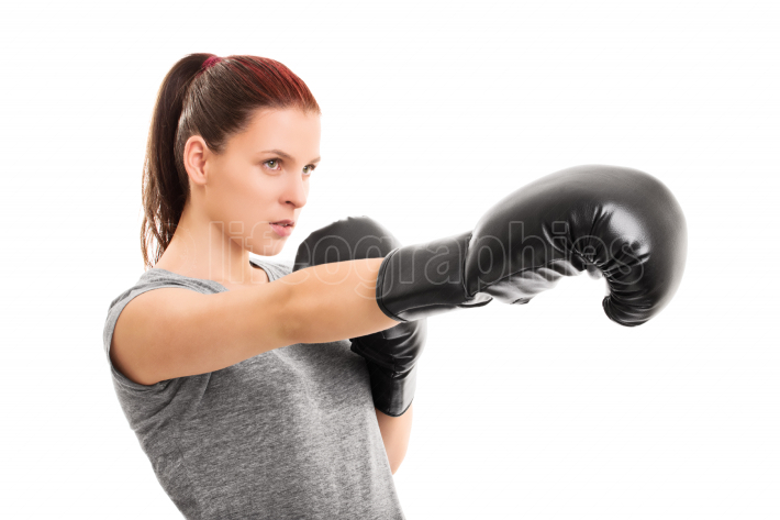 Young female boxer punching