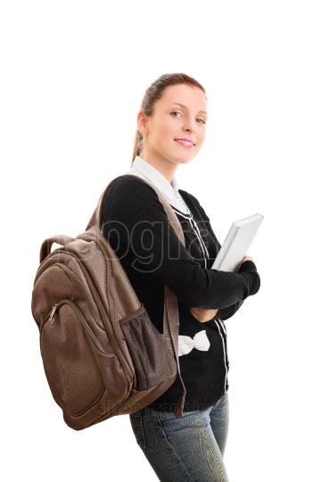 Young female student with a backpack holding a book