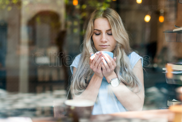 Young girl enjoying a coffee