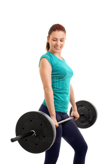Young girl holding a barbell