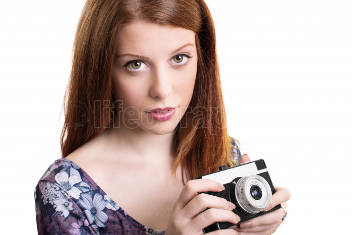 Young girl holding a retro film camera