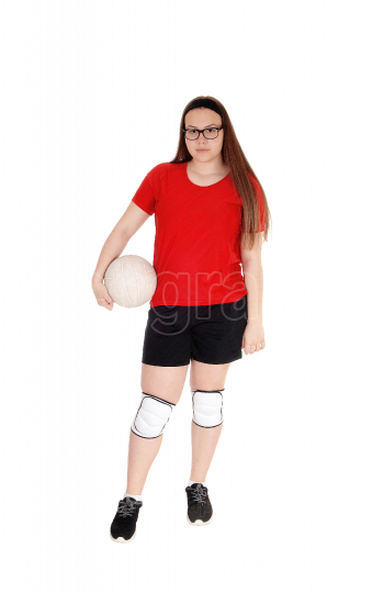 Young girl holding her volley ball in her hand