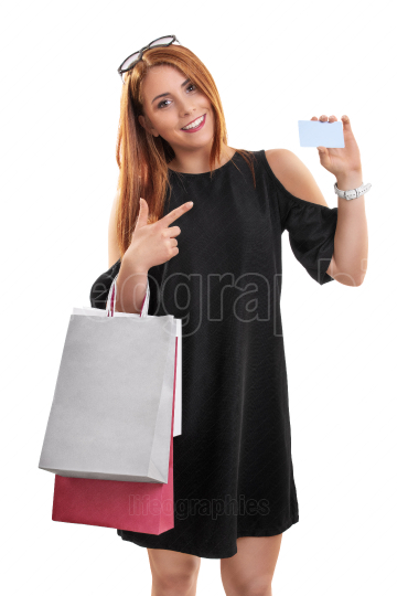 Young girl holding shopping bags and a card