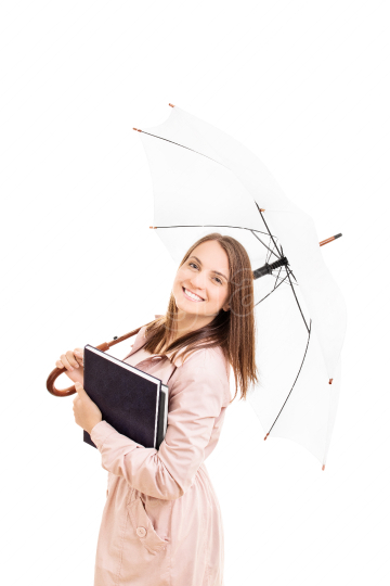 Young girl holding some books and an umbrella