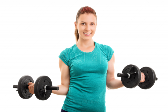 Young girl holding two dumbbells