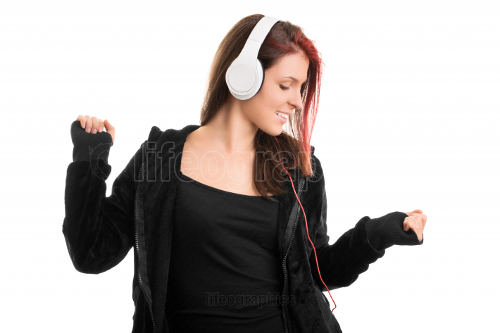 Young girl in a hooded sweatshirt dancing to her favorite song