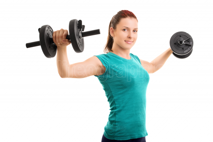 Young girl lifting dumbbells