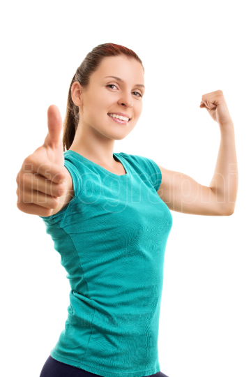 Young girl making thumbs up while exercising