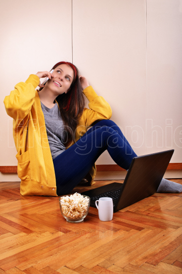 Young girl on her phone preparing to watch a movie