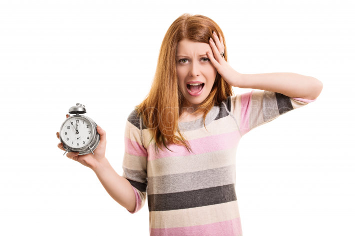 Young girl panicking about being late