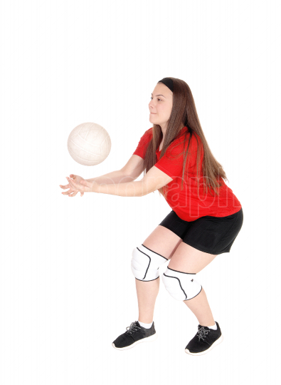 Young girl playing volley ball
