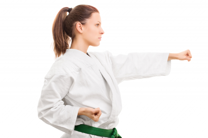 Young girl wearing kimono in combat stance