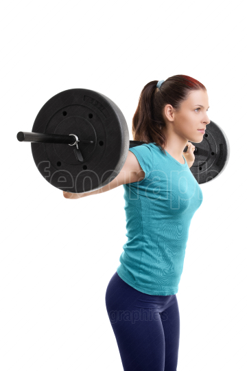 Young girl with barbell