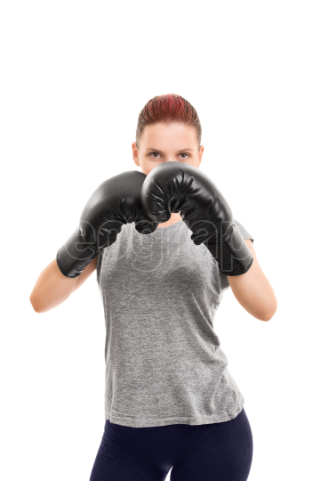 Young girl with boxing gloves blocking