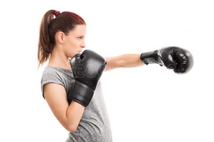 Young girl with boxing gloves punching