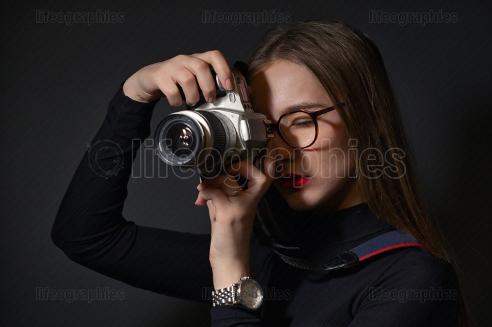Young Girl With Film Camera