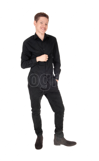 Young handsome teenager boy standing in a black outfit