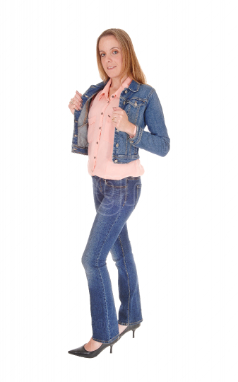 Young lady standing in jeans and jacket