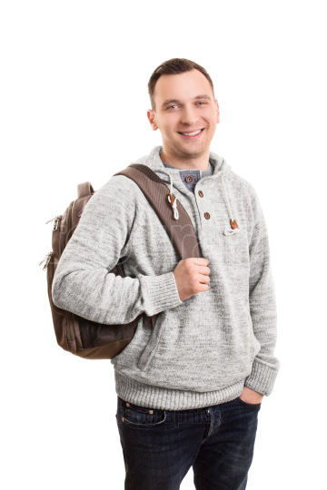 Young male student with a backpack