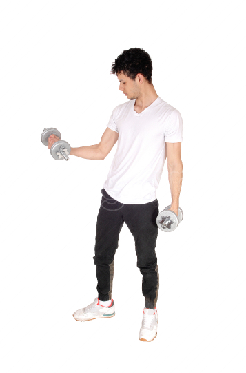 Young man exercising with two dumbbells