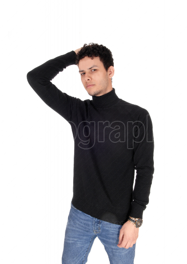 Young man in a black sweater and jeans one hand on head