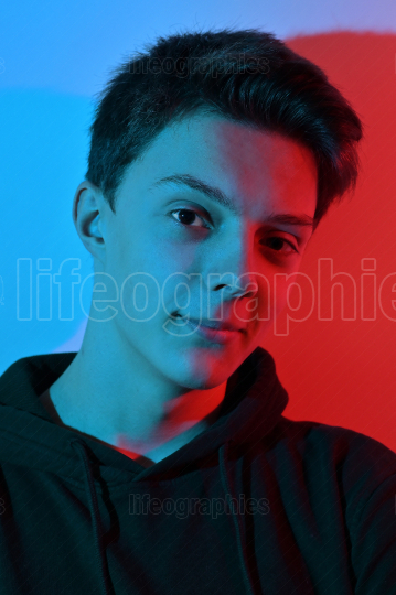 Young Man Portait And Colored Lights
