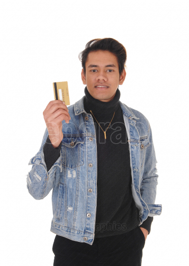 Young man showing his credit card happy