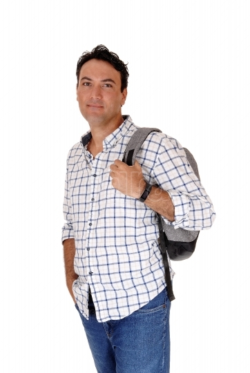 Young man standing with his backpack