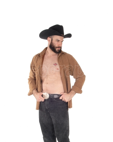 Young man with open shirt and cowboy hat