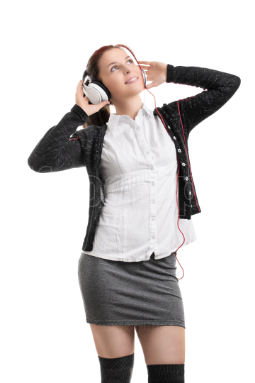 Young student girl with headphones listening to music