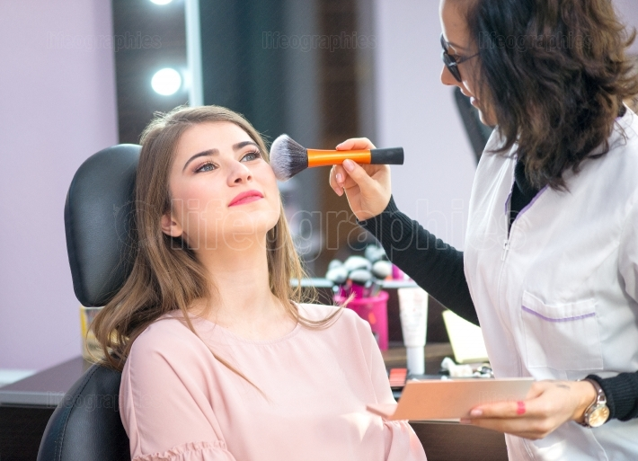 Young woman at salon for a make up
