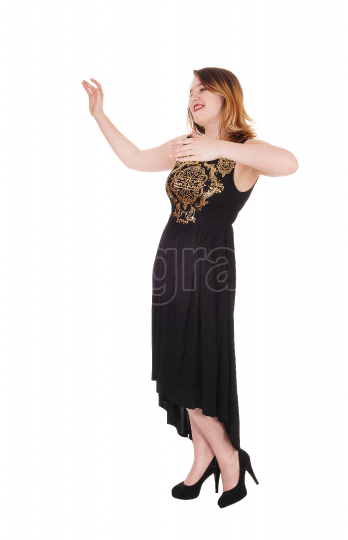 Young woman dancing in a black dress