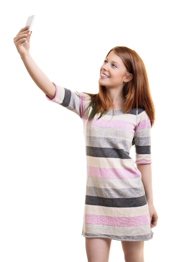 Young woman in a casual dress taking a selfie