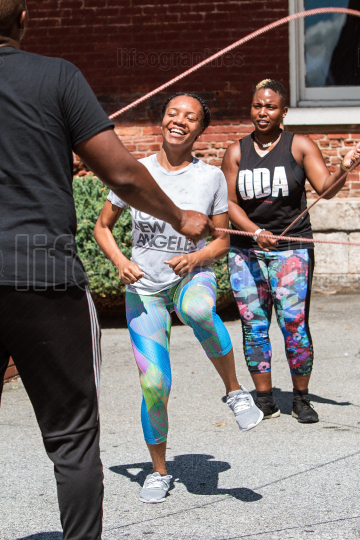 Young Woman Jumps Rope Double Dutch Style At Fitness Event