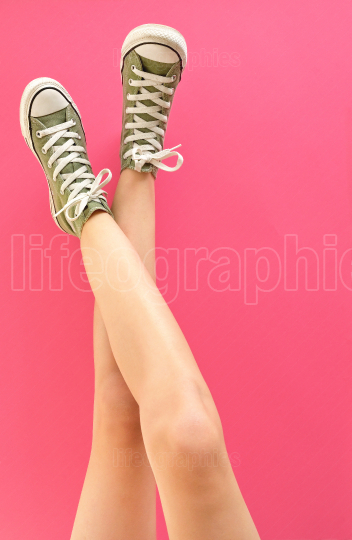 Young Woman Legs In Shoes Sneakers