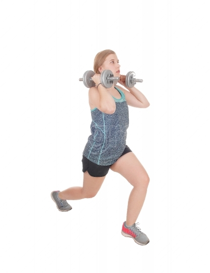 Young woman lifting her two dumbbell s