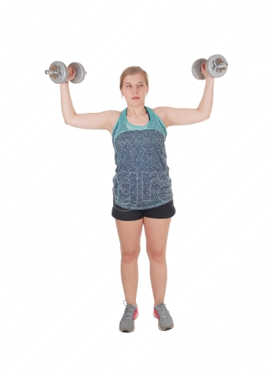 Young woman lifting two dumbbell s