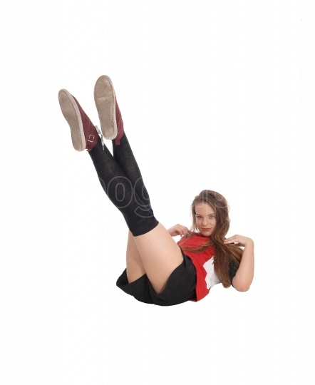 Young woman lying on the floor, legs up